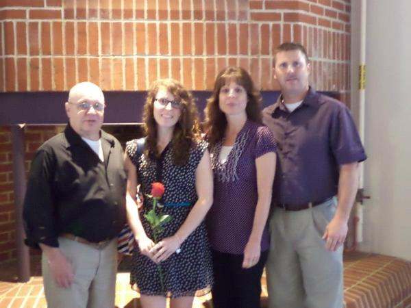 My pappy, me, my mom, and my daddy at a reception for my research.